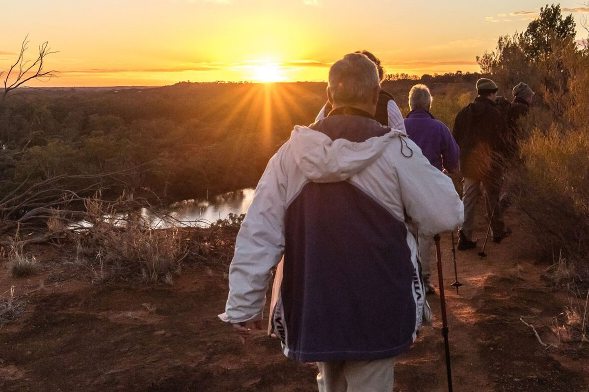 Walk as the sun rises to Headings Cliff on the Murray River Walk in South Australia.